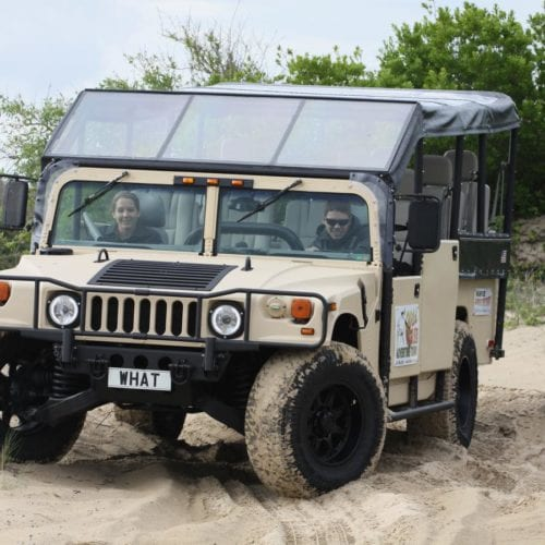 adventure tour hummer in sand
